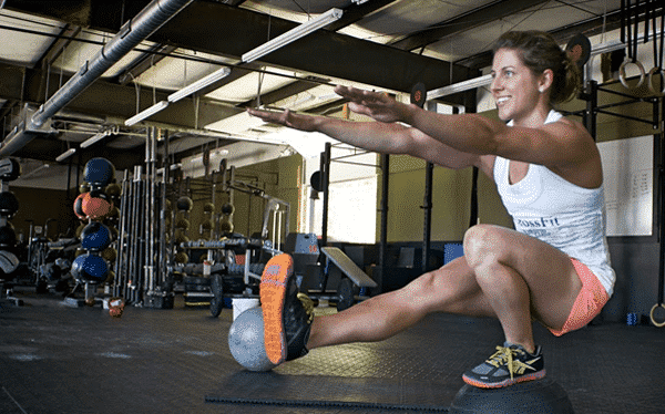 Pistol squats tijdens een workout of the day